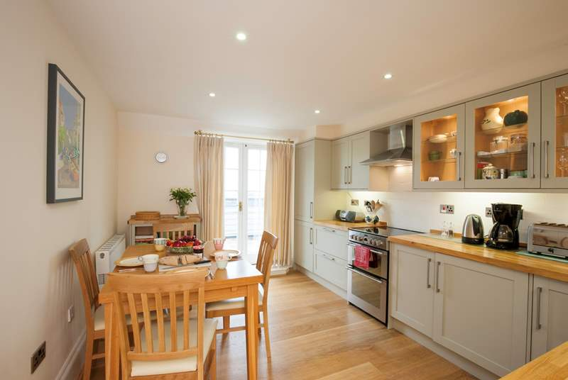 The delightful kitchen with patio doors out the balcony where you can enjoy your lunch in the sunshine
