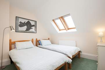 The light twin bedroom is spacious and has plenty of wardrobe space