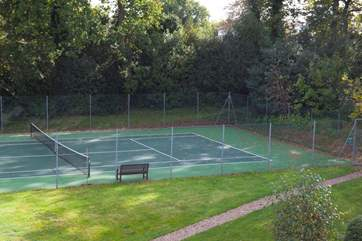 Play a spot of tennis on the shared courts