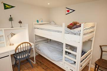 The bunk bedroom is adorable and great for the younger ones in your party.
