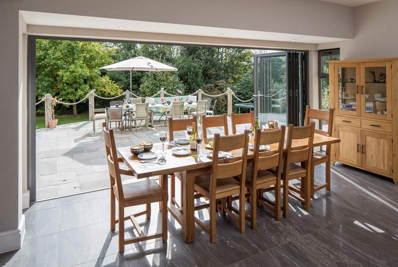 Folding doors open out onto the terrace, bringing the light and sunshine inside. (The garden furniture shown in this photo has been replaced with the set shown in photos 4 and 5)