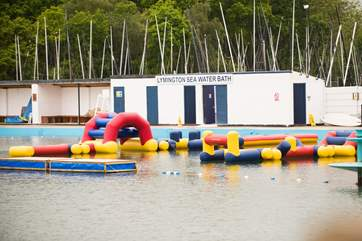 Have an energetic day on the inflatable obstacle course at the Salt Water Baths in nearby Lymington.
