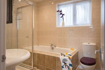 The family bathroom has a jacuzzi bath and separate shower cubicle.