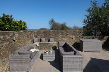 There is plenty of comfy outdoor furniture for everyone to relax.