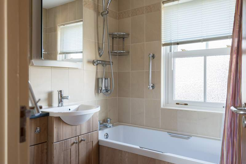 The family bathroom has a fitted shower above the bath.