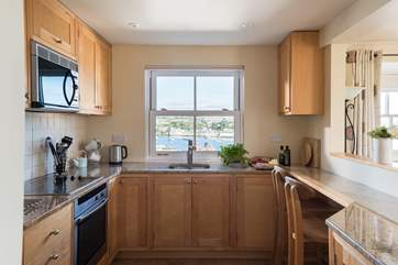The kitchen-area shows the quality of the cottage, with birds eye maple units and granite work surfaces.