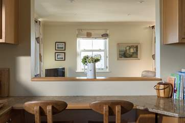 The breakfast-bar in the kitchen, complete with bespoke, locally-made chairs.