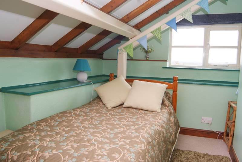 This is the single bedroom, with views across the open farmland.
