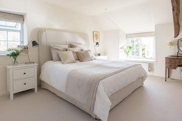 This is the master bedroom in the farmhouse. What a luxurious space, with a 6ft king-size bed and views out across the gardens and the valley beyond, Bedroom 1 is the master bedroom.
