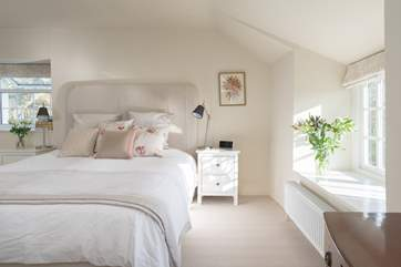 The master bedroom is light, beautifully decorated and presented and has plenty of storage space.