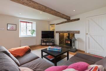There is a really snug living-room in the main farmhouse too, a lovely room away with large TV, great library of DVDs and a wood-burning stove.