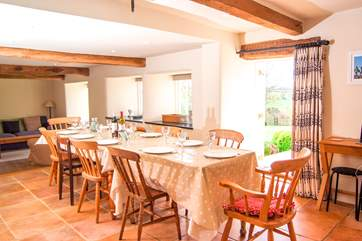 There is a wonderful farmhouse kitchen with a space for your whole party to eat together - same outside!