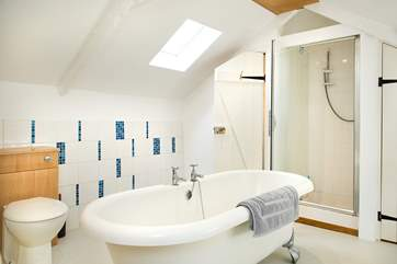 The family bathroom has a separate shower and gorgeous free-standing bath!