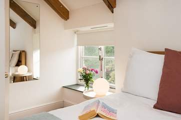 The contemporary design complements the character of the deep window sills and exposed beams.