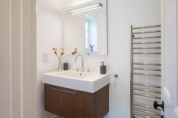 The en suite shower-room has a large cubicle and drench head.