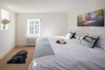 Bedroom 2 can be made up as a 6ft bed or two 3ft beds, stylish shutters add to the contemporary decor in this cottage.