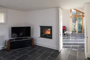 The snug has a Smart TV with sports channel package and shares the same cosy wood-burner.
