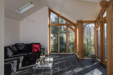 Beautifully designed with cosy under-floor heating and a wood-burner.