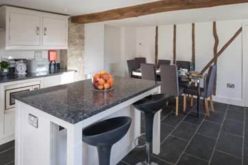 The utility-area is through the door, with a large fridge/freezer, washing machine, tumble-drier and lots of storage space.