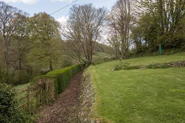 The garden faces south west and has great views across Branscombe Vale, please supervise small children as this haw-haw is at the side of the lawn.