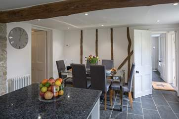 The dining-area of this delightful open plan space, the room to the left has a large fridge freezer, washing machine and tumble drier and lots of storage space.