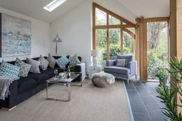 The vaulted sitting-room has a green oak and glass front giving views of the garden from the comfort of the sofa.