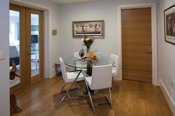 What a lovely use of this space. Close all doors and create the perfect dining area.