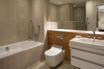The en suite for the master bedroom is huge! It includes a bath with shower attachment along with a large shower cubicle.
