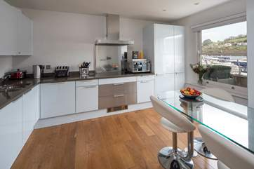 Even the kitchen boasts an amazing view. The kitchen offers all mod-cons and is fully equipped for all occasions.
