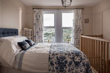 The bedroom shares the views across the valley to Heligan.