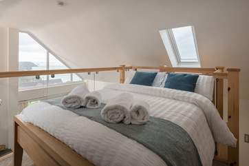 The mezzanine level is cosy with a double bed.