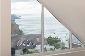 The view of the coastline from the mezzanine bedroom area at Ocean Retreat.