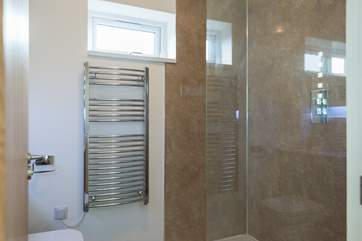 The spacious shower-room has a double size cubicle and power shower.