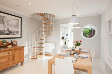 The spiral staircase is a beautiful feature in the  sitting/dining-room.