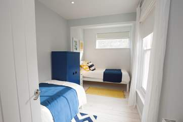 The lovely twin bedroom is perfect for children or adults alike.