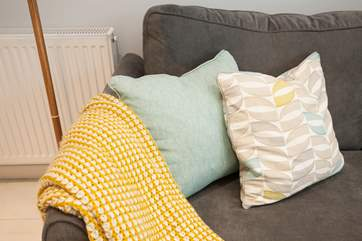 In the colder months, curl up on the sofa with a blanket.