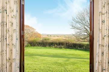 Fling open the patio doors in the master bedroom and enjoy the fabulous view.