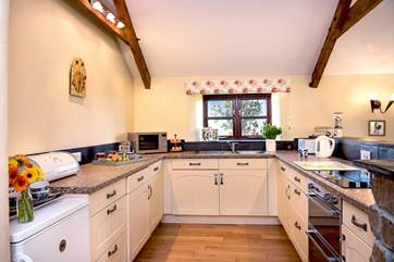 The light and airy, well-equipped kitchen.