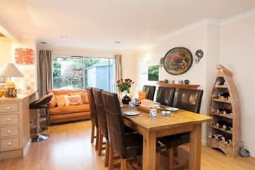 The lovely large dining table is a great place to enjoy your holiday mealtimes