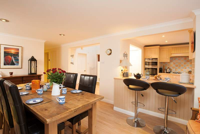 The open plan kitchen dining room with doors leading out onto the patio