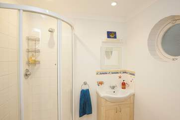The downstairs shower-room is perfect to wash off the sand from inbetween your toes after a day on the beach
