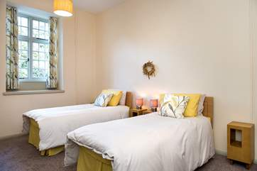 The pretty twin bedroom on the ground floor - perfect for adults or children alike.