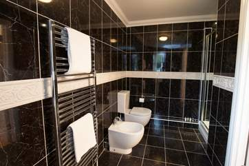 One of the three bathrooms, with a separate shower cubicle.