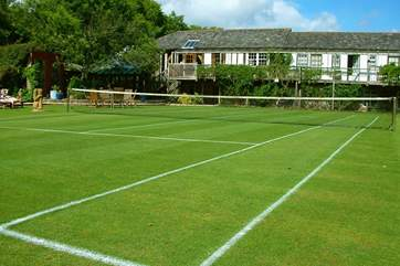 What a stunning lawn tennis court. Equipment can be supplied should you fancy a game.