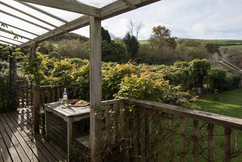 Enjoying a spot of breakfast or an evening drink on this delightful balcony is a real pleasure looking across the tennis courts and out over the rolling countryside.