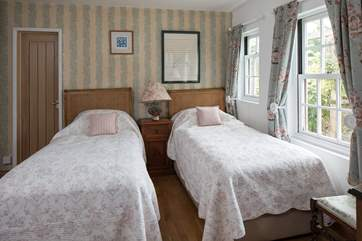 The light and airy twin room. Perfect for adults and children alike.