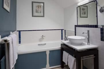 The en suite bathroom to the twin room.