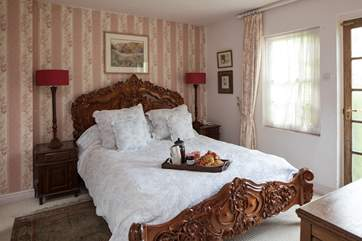 The master bedroom comprises of this rather grand, king-size bed.