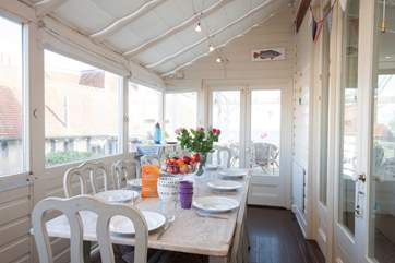 Enjoy mealtimes in the elegant conservatory-style dining-room with the light flooding in even on the dullest of days.