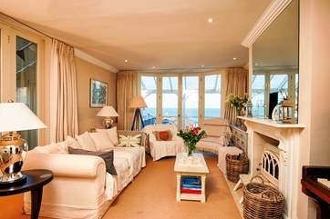 The stunning main sitting-room, doors take you out onto the balcony with views over the Solent, take a deep breath of that wonderful sea air.